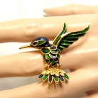 Vintage designer kolibrie broche met groen en blauw emaille.